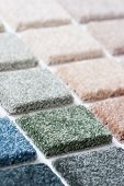Carpet samples in many shades and colors poster