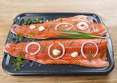 Wild Pacific Salmon Fillets in Bake Pan with fresh herbs on Bamboo Board poster