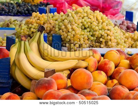 Fresh Organic Peaches, Grapes And Bananas
