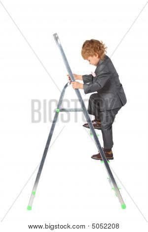 Boy In Suit Rises On Step-ladder