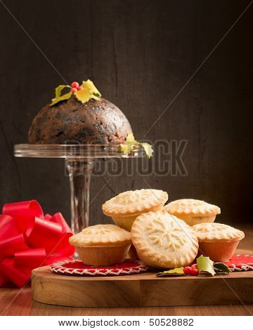 Christmas mince pies and pudding with festive setting