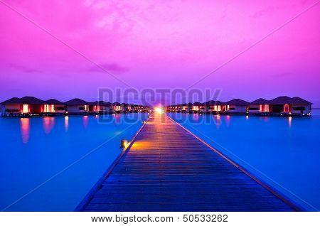 Beautiful sunset over resort in Maldives