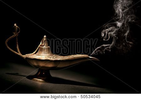 Magical Geni Lamp With Smoke And Black Background