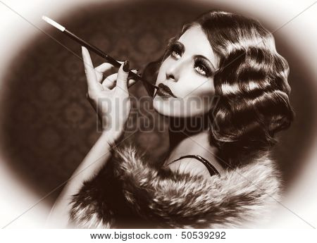Retro Woman Portrait. Beautiful Woman with Mouthpiece. Cigarette. Smoking Lady. Vintage Styled Black and White Photo. Old Fashioned Makeup and Finger Wave Hairstyle. 20's or 30's style. Sepia toned