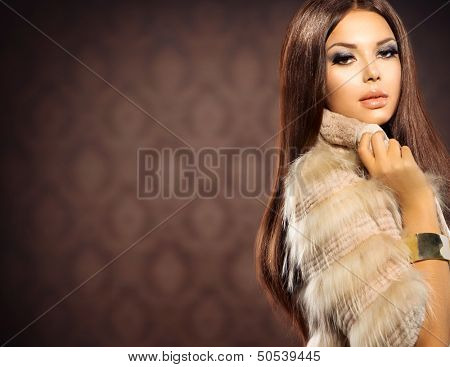 Beauty Fashion Model Girl in Fox Fur Coat. Beautiful Woman in Luxury Red Fur Jacket