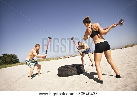 Athletes Doing Workout On Beach
