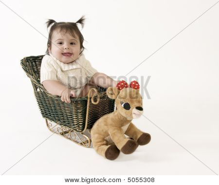 Happy Baby In Sleigh