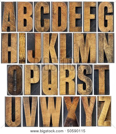 complete English alphabet - a collage of 26 isolated vintage wood letterpress printing blocks, scratched and stained by ink