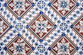 Closeup detail of ornamental old typical tiles from Portugal. poster
