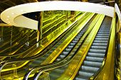Yellow move escalator in modern office centre poster