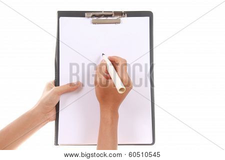 Female Hand Holding And Writing On Blank Clipboard