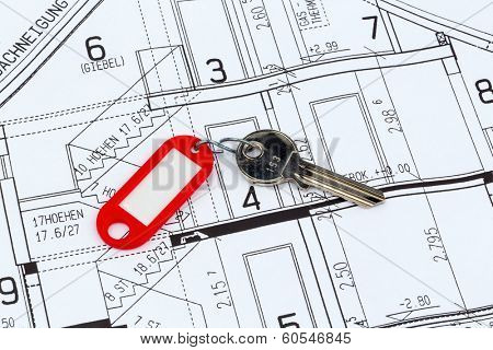 an architect's blueprint with the key of an apartment or a new house