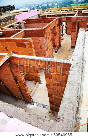 a detached house is built of solid construction with brick.