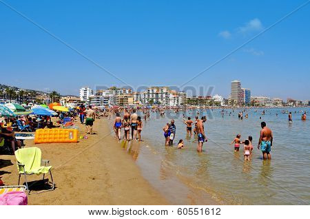 PENISCOLA, SPAIN - JULY 26: Bathers in North Beach on July 26, 2013 in Peniscola, Spain. The town is a typical summer destination facing the Mediterranean Sea, in the North of the Valencian Community