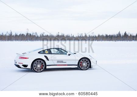 LEVI, FINLAND - FEB 20: a PORSCHE 911 TURBO car during Porsche Driving Experience Snow & Ice Press Event on February 20, 2014 in LEVI, FINLAND