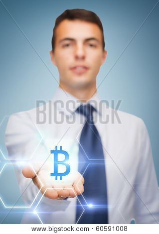 business and office, advertising, people concept - friendly young buisnessman showing bit coin sign on the palm of his hand