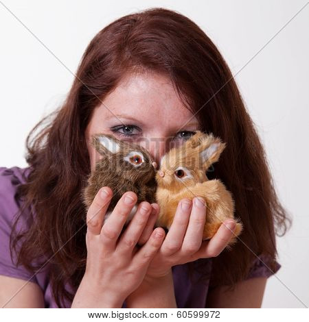 young women with two bunnies, soft toy at easter