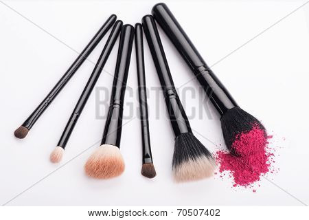 Close-up of  professional  make-up brush with crashed pink eye s