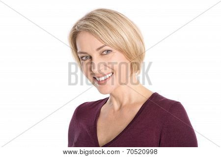 Portrait: Isolated Face Of A Smiling Attractive Older Blond Woman.