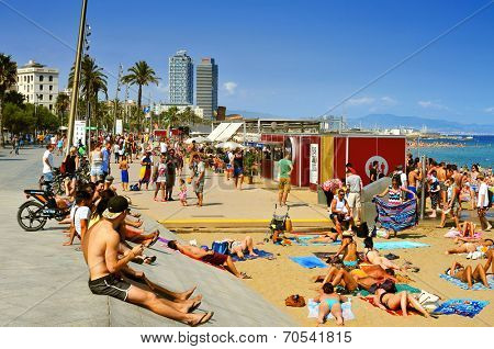 BARCELONA, SPAIN - AUGUST 19: A crowd of bathers in La Barceloneta Beach on August 16 2013 in Barcelona, Spain. This popular beach hosts about 500,000 visitors from everywhere during the summer season