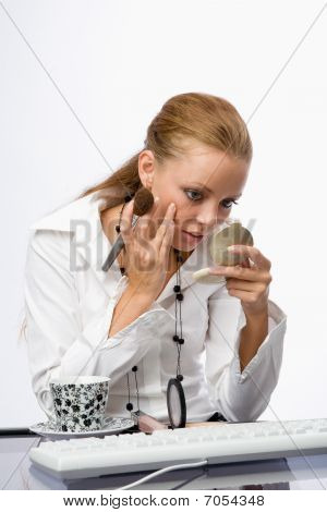 Girl Enjoys Cosmetics In The Workplace