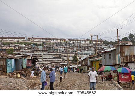 KIBERA, KENYA-DECEMBER 6 2010: Unidentified people go about their business in Kibera, Nairobi Kenya's largest slum.