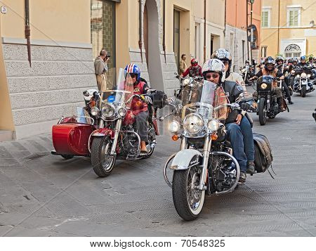 A Group Of Bikers Riding Harley Davidson