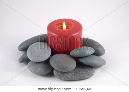 Candle And Rocks