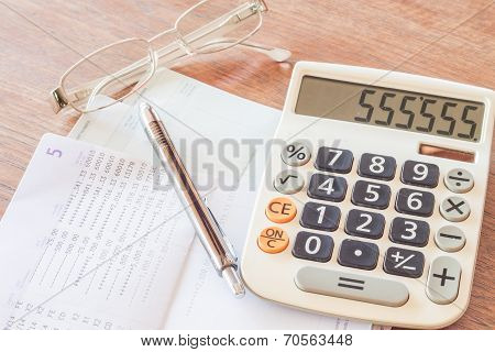 Calculator, Pen And Eyeglasses With Bank Account Passbook