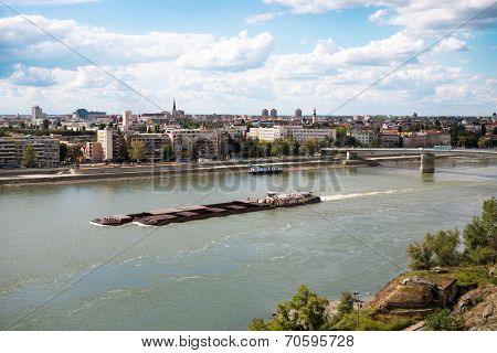 Containership or barge on the river