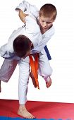 Active athletes in  judogi are performing throws poster