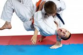 Sportsman with a blue belt doing judo throw poster