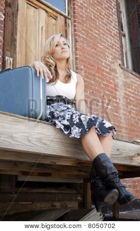 Sad Girl With Suitcase