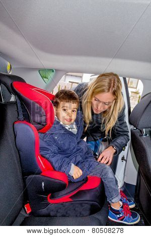 boy in a car seat, symbol of protection, care, vehicle safety