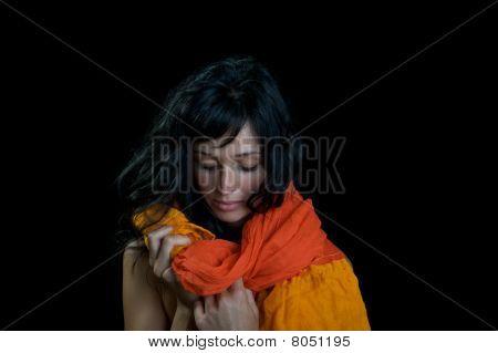 Ethnic woman on black.