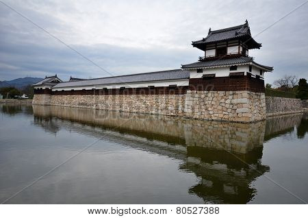 Entrance At Hiroshima Castle With Wall And Water Pond