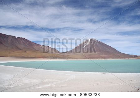 Green lagoon and Volcano in Atacama desert, Bolivia