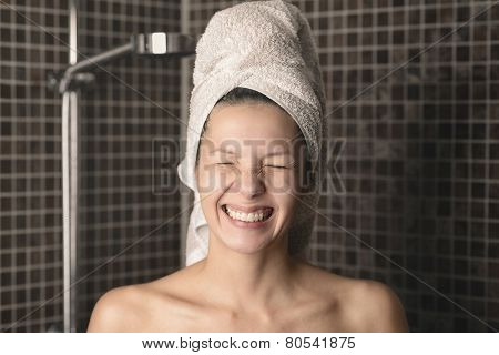 Playful Mischievous Woman With Wet Hair In A Towel