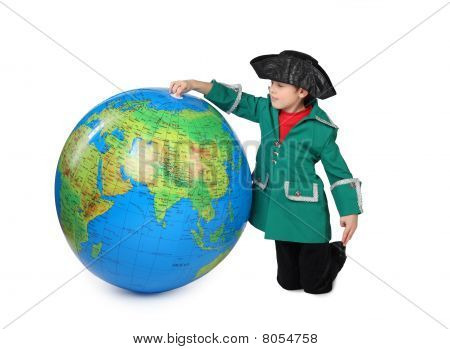 Boy In Historical Dress Sits Near Big  Inflatable Globe Isolated On White