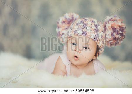 Happy little girl in cap bear