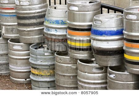 Metal Beer Kegs Stacked Up Outside Of A Bar