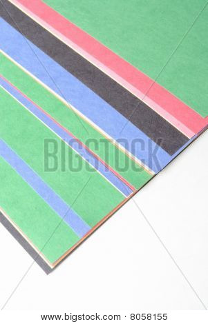 Construction paper spread out on white background. poster