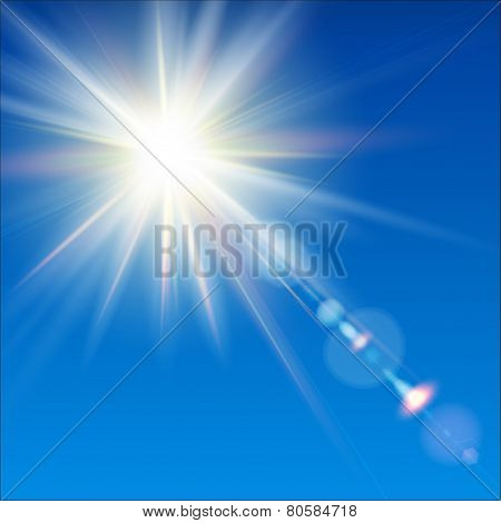 The bright sun shines on a blue sky background.