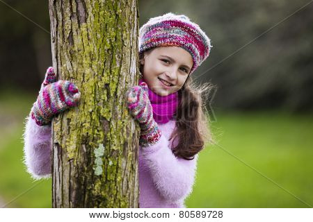Female child hugging a tree