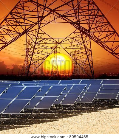 Sun Set With Structure Of High Voltage Electric Power Tower And Solar Cell Panel In Energy Farm