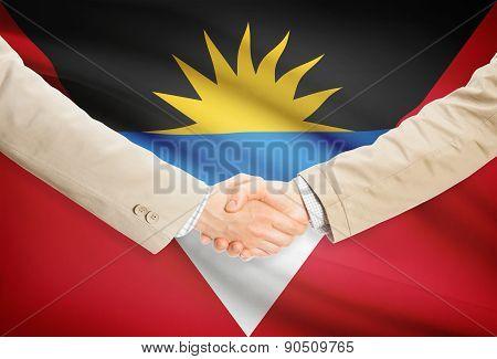 Businessmen Handshake With Flag On Background - Antigua And Barbuda