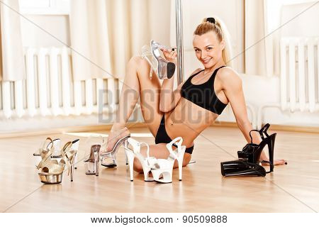 Young Slim Pole Dance Woman Choosing Shoes For Strip Tease