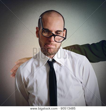 Sad businessman  comforted