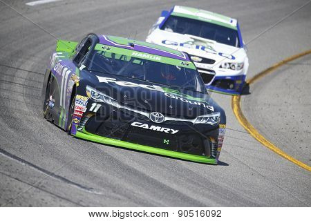 Richmond, VA - Apr 24, 2015:  Denny Hamlin (11) brings his race car through the turns during a practice session for the Toyota Owners 400 race at the Richmond International Raceway in Richmond, VA.