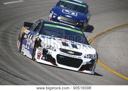 Richmond, VA - Apr 24, 2015:  Tony Stewart (14) brings his race car through the turns during a practice session for the Toyota Owners 400 race at the Richmond International Raceway in Richmond, VA.